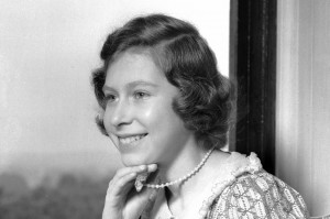Princess Elizabeth (Queen Elizabeth II) pictured smiling with a book at Windsor Castle, Berkshire, Great Britain, 22 June 1940. (Photo by Lisa Sheridan/Studio Lisa/Getty Images)