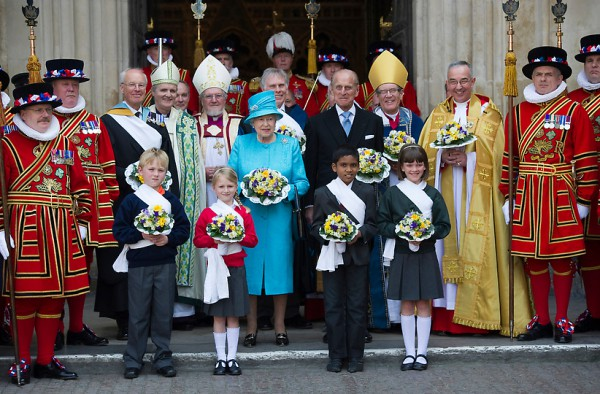 Britain's Queen Elizabeth II, celebrating her 85th birthday, and Prince Philip attend the traditional Royal Maundy Service at Westminster Abbey in London, Thursday April 21, 2011. According to Buckingham Palace, it was the first time the Queen's birthday had fallen on Maundy Thursday. Each Maundy money recipient - all retired pensioners invited in recognition of their service to the church and the community - will receive two purses - one red and one white - in the centuries-old tradition. The red purse contains a 5 pound ( US$ 8.15: euro 5.6) coin commemorating the Duke of Edinburgh's 90th birthday in June, and a 50p (US$ 0.82: euro 0.57) coin marking the 2012 London Olympic Games. The white purse holds uniquely minted Maundy Money of silver one, two, three and four penny pieces, the sum of which equals the Queen's age. (AP Photo/Arthur Edwards, pool)